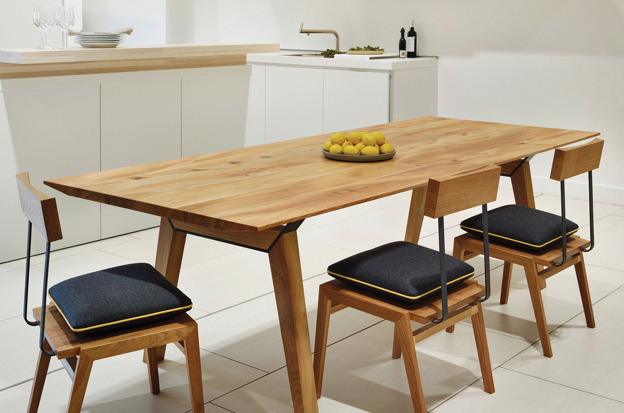 Dining tables and chairs are designed and made in our workshop in Bristol
